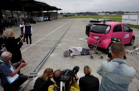 A crash test dummy with rollator is lying on the ground after collision with Mitsubishi i-MiEV electric car in a controlled crash test from insurer AXA, in Duebendorf