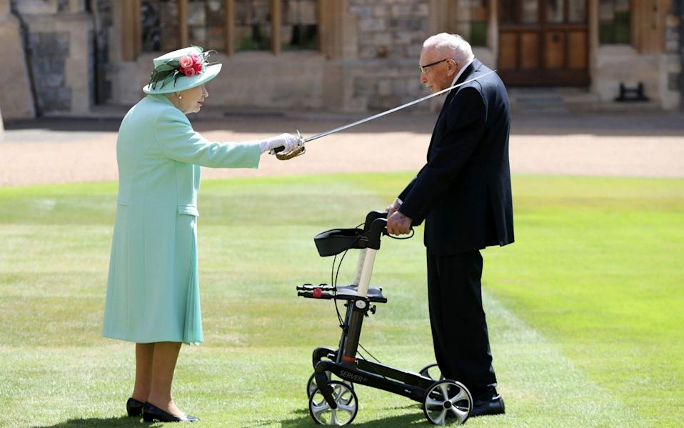 Captain Tom receiving his knighthood from the Queen during a special ceremony at Windsor Castle - Chris Jackson/PA