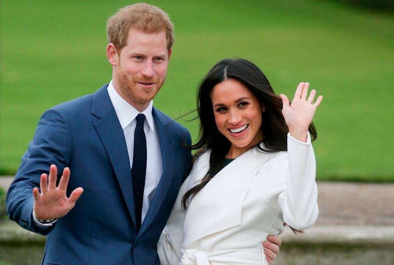 Prince Harry and his former US actress wife Meghan Markle pose for a photograph in the Sunken Garden at Kensington Palace in west London on November 27, 2017, following the announcement of their engagement.