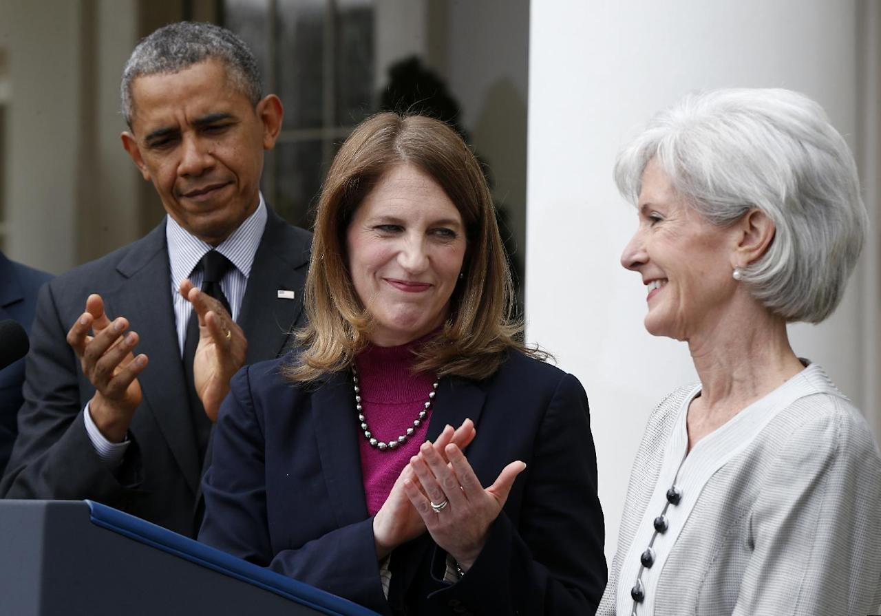 President Barack Obama, and his nominee for Health and Human Services Secretary, current Budget Director Sylvia Mathews Burwell, center, applaud outgoing Health and Human Services Secretary Kathleen Sebelius, Friday, April 11, 2014, in the Rose Garden at the White House in Washington. The moves come just over a week after sign-ups closed for the first year of insurance coverage under the so-called Obamacare law.(AP Photo/Charles Dharapak)
