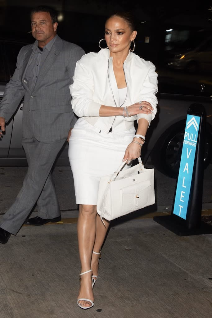 "Jennifer Lopez looks chic in all-white as she goes for dinner in South Beach - before a cake was dropped on her lap. The singer, who is in final preparations for her high profile Superbowl half-time performance, showed off her incredible shape in a revealing outfit as she hit up one of Miami Beach's hottest new restaurants, Papi Steak, with Alex Rodriguez. The pair were celebrating her manager Benny Medina's birthday and looked on with excitement as a six-tier cake was brought out for him and placed on a table just in front of them. But J Lo for once will have wished she wasn't in the front row. Soon after everyone had done their speeches and Instagram videos, a waiter accidentally spilled some of the cake on the singer's lap. But she was no diva about it. ""There was a stunned silence for a second, but fortunately she just laughed it off,"" said a source. ""Jlo an Arod were both very nice about it and tried to defend the waiter as it was just an accident. She was very sweet about the whole situation. She said something like - 'at least I didn't pay for this jacket'."". 24 Jan 2020 Pictured: Jennifer Lopez and A-Rod. Photo credit: MEGA TheMegaAgency.com +1 888 505 6342 (Mega Agency TagID: MEGA593302_001.jpg) [Photo via Mega Agency]"