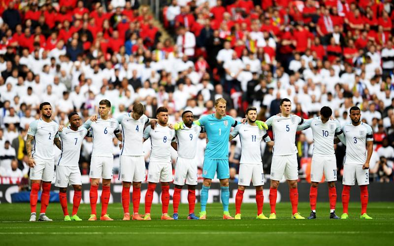 The England team observe a one minutes silence to remember those who lost their lives in the recent Westminster terrorist attacks prior to the FIFA 2018 World Cup Qualifier between England and Lithuania at Wembley Stadium - Credit: Getty Images