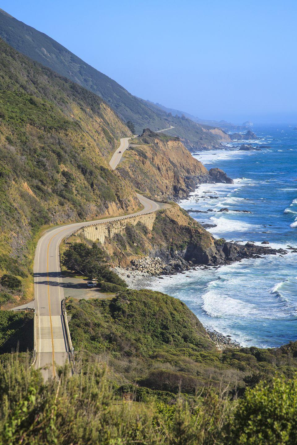 """<p><strong>The Drive: </strong><a href=""""https://www.tripadvisor.com/Attraction_Review-g28926-d147161-Reviews-Pacific_Coast_Highway-California.html"""" rel=""""nofollow noopener"""" target=""""_blank"""" data-ylk=""""slk:Pacific Coast Highway"""" class=""""link rapid-noclick-resp"""">Pacific Coast Highway</a></p><p><strong>The Scene:</strong> If you're pressed for time, but still want to behold California's beauty, take this cliff-side drive from Monterey to Morro Bay. Coast along the 139-mile route and you'll see <a href=""""https://www.tripadvisor.com/Tourism-g240329-Big_Sur_California-Vacations.html"""" rel=""""nofollow noopener"""" target=""""_blank"""" data-ylk=""""slk:Big Sur's"""" class=""""link rapid-noclick-resp"""">Big Sur's</a> Bixby Bridge, picturesque <a href=""""https://www.tripadvisor.com/Tourism-g32172-Carmel_Monterey_County_California-Vacations.html"""" rel=""""nofollow noopener"""" target=""""_blank"""" data-ylk=""""slk:Carmel-by-the-Sea"""" class=""""link rapid-noclick-resp"""">Carmel-by-the-Sea</a>, the <a href=""""https://www.tripadvisor.com/Attraction_Review-g33039-d207444-Reviews-Hearst_Castle-San_Simeon_San_Luis_Obispo_County_California.html"""" rel=""""nofollow noopener"""" target=""""_blank"""" data-ylk=""""slk:Hearst Castle"""" class=""""link rapid-noclick-resp"""">Hearst Castle</a>, and much more on the way.</p><p><strong>The Pit-Stop:</strong> Stop at <a href=""""https://www.tripadvisor.com/Attraction_Review-g240329-d116839-Reviews-Pfeiffer_Big_Sur_State_Park-Big_Sur_California.html"""" rel=""""nofollow noopener"""" target=""""_blank"""" data-ylk=""""slk:Pfeiffer State Beach"""" class=""""link rapid-noclick-resp"""">Pfeiffer State Beach</a> for photo-ops with the Pacific Ocean. </p>"""