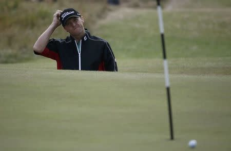 Michael Hoey of Northern Ireland gestures during the second round of the British Open Championship at the Royal Liverpool Golf Club in Hoylake