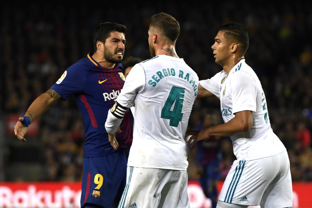 Luis Suarez and Sergio Ramos were two of the chief instigators in a wild game between Barcelona and Real Madrid. (Getty)