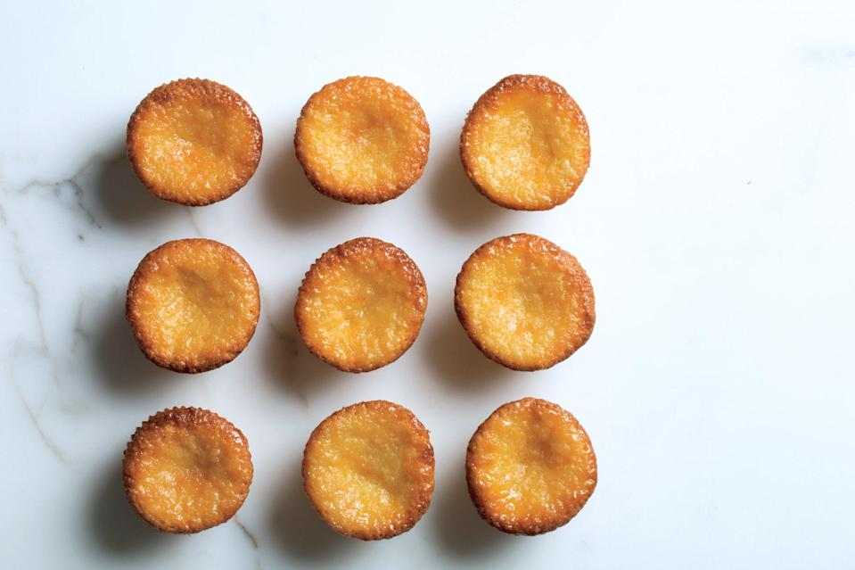 "These simple little cakes are made in a standard muffin tin and boast bright lemon flavor and a marzipan-like chew. <a href=""https://www.epicurious.com/recipes/food/views/semolina-lemon-syrup-cakes?mbid=synd_yahoo_rss"" rel=""nofollow noopener"" target=""_blank"" data-ylk=""slk:See recipe."" class=""link rapid-noclick-resp"">See recipe.</a>"
