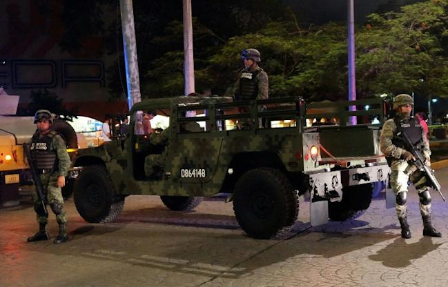 Three dismembred bodies were found in the Mexican beach resort of Cancun, scene of an armed confrontation between police and criminal gangs. Troops shown here were dispatched to help restore calm