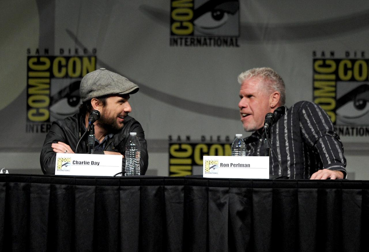 """SAN DIEGO, CA - JULY 14:  (L-R) Actors Charlie Day and Ron Perlman speak at Warner Bros. Pictures and Legendary Pictures Preview of """"Pacific Rim"""" during Comic-Con International 2012 at San Diego Convention Center on July 14, 2012 in San Diego, California.  (Photo by Kevin Winter/Getty Images)"""