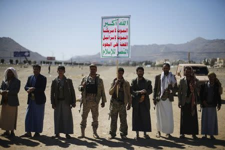 Followers of the Houthi movement attend a gathering to show support to the movement outside the Presidential Palace in Sanaa