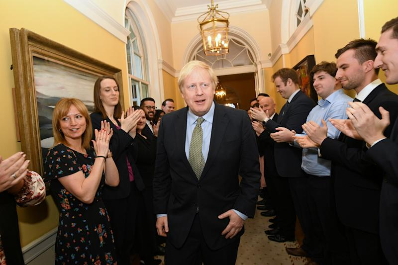 Britain's Prime Minister Boris Johnson is greeted by staff as he arrives back at Downing Street, after meeting Queen Elizabeth and accepting her invitation to form a new government, in London, Britain December 13, 2019. Stefan Rousseau/Pool via REUTERS