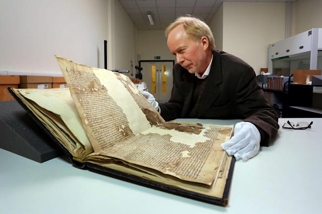 Dr. Mark Bateson, Community History Officer with Kent County Council with an original Magna Carta from the issue made in 1300 by King Edward l to the borough of Sandwich in Kent, which he recently discovered in the archives at Kent County Council's Kent History and Library Centre in Maidstone.