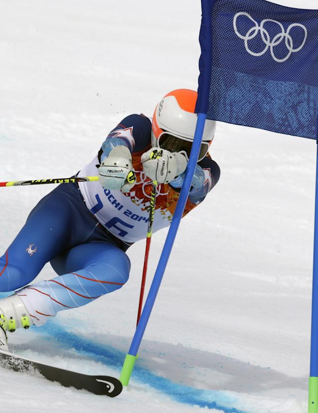 United States' Bode Miller skis past a gate during the first run of the men's giant slalom the Sochi 2014 Winter Olympics, Wednesday, Feb. 19, 2014, in Krasnaya Polyana, Russia. (AP Photo/Charles Krupa)