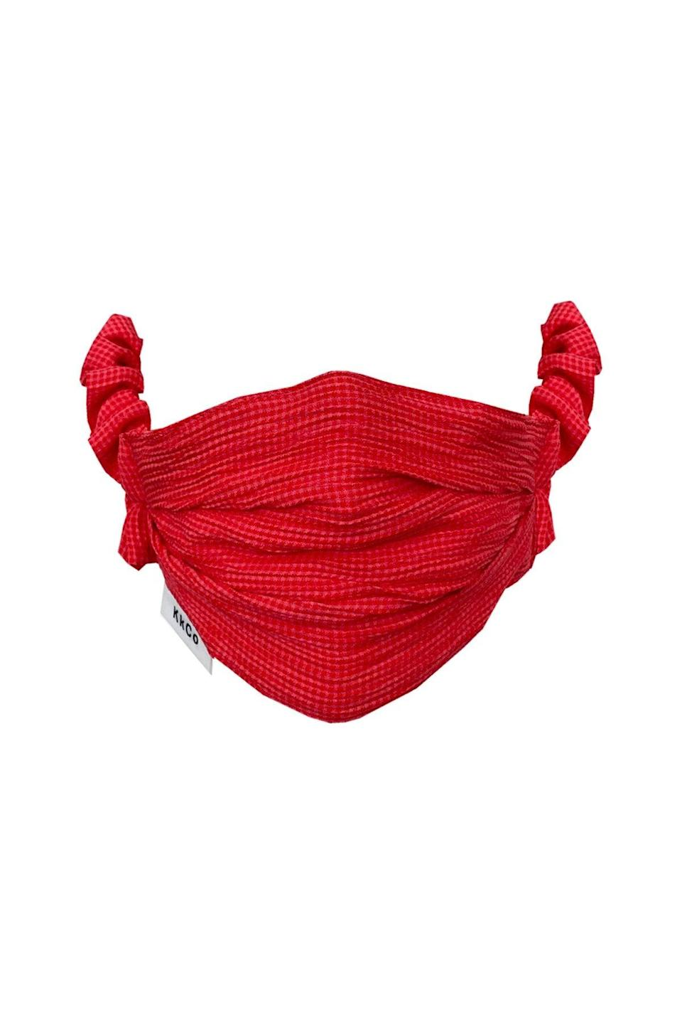 "<br> <br> <strong>KKCo</strong> Face Mask in Red Check, $, available at <a href=""https://go.skimresources.com/?id=30283X879131&url=https%3A%2F%2Fwww.kkcostudio.com%2Fproducts%2Fface-mask-in-red-check"" rel=""nofollow noopener"" target=""_blank"" data-ylk=""slk:KKCo"" class=""link rapid-noclick-resp"">KKCo</a>"
