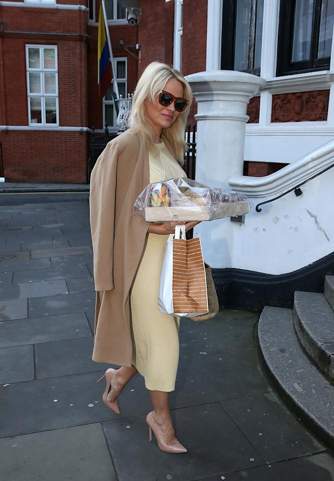 """<p>The actress checked up on Assange <a rel=""""nofollow"""" href=""""http://people.com/politics/pamela-anderson-visits-julian-assange/"""">again in November</a>, again toting treats. """"Pamela has visited Julian a number of times,"""" Anderson's publicist <a rel=""""nofollow"""" href=""""http://people.com/politics/pamela-anderson-visits-wikileaks-founder-julian-assange-again-snacks/"""">told PEOPLE in a statement</a>. """"She likes to make him smile - she is a dear supporter of his. She is concerned for his well being, and believes he's committed no crime and has been treated unkind, and unfairly.""""</p>"""