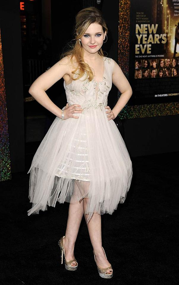 Following in Lea's footsteps was 15-year-old Abigail Breslin, who popped a pose in a fun and festive Marchesa Fall 2011 frock. Her smoky eyes, half-up hair, and gold stilettos made her look even more grown up! (12/05/2011)