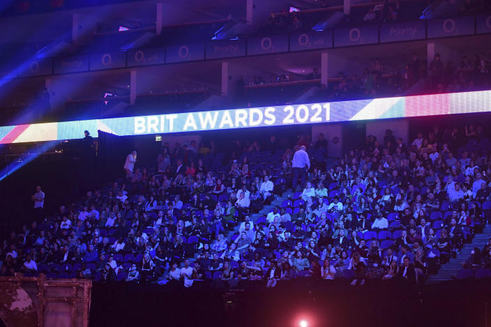 People in the crowd during the Brit Awards 2021 at the O2 Arena, in London, Tuesday, May 11, 2021. (Ian West/PA via AP)