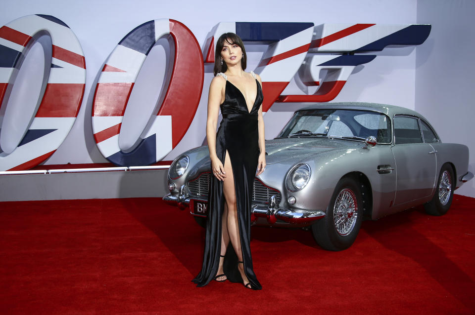 Ana de Armas poses for photographers upon arrival for the World premiere of the new film from the James Bond franchise 'No Time To Die', in London Tuesday, Sept. 28, 2021. (Photo by Joel C Ryan/Invision/AP)