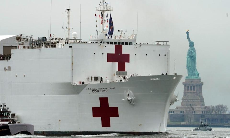 The USNS Comfort medical ship moves up the Hudson river, past the Statue of Liberty as it arrives in New York City in March.