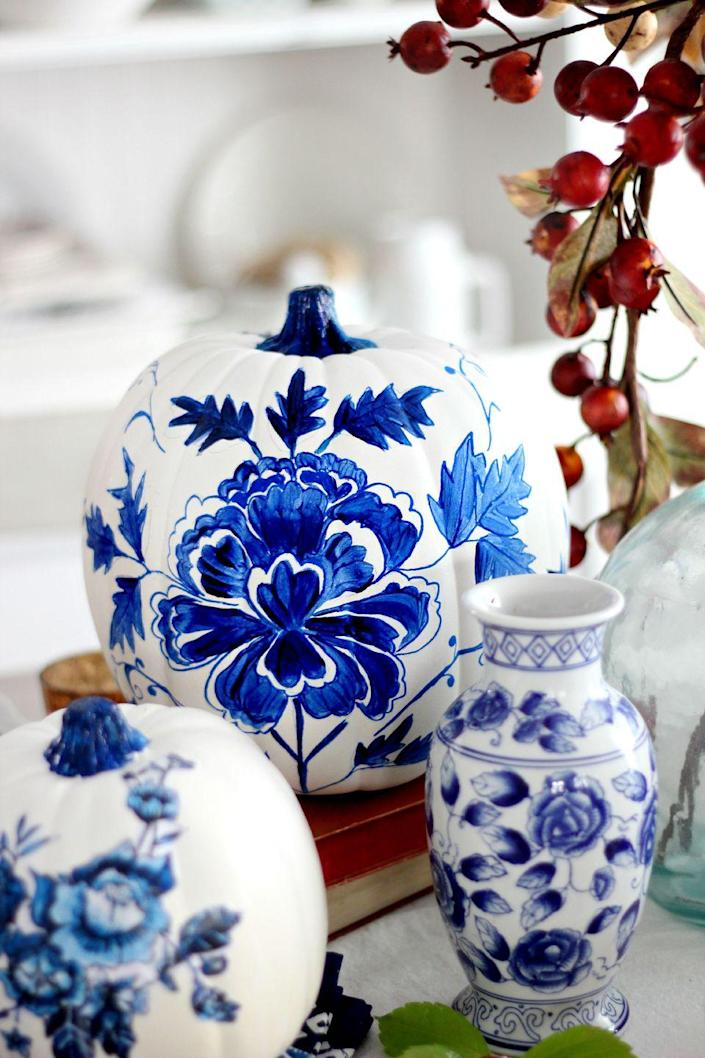 """<p>Your pumpkins will look extra elegant when you design them to look like porcelain. </p><p><em><strong>Get the tutorial from <a href=""""http://www.craftberrybush.com/2015/09/blue-porcelain-craft-pumpkin-and-free-printable.html"""" rel=""""nofollow noopener"""" target=""""_blank"""" data-ylk=""""slk:Craftberry Bush"""" class=""""link rapid-noclick-resp"""">Craftberry Bush</a>.</strong></em></p>"""