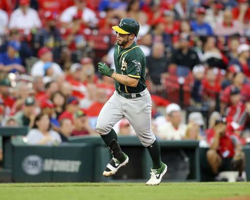 Oakland Athletics' Beau Taylor runs the bases after hitting a solo home run during the fourth inning of a baseball game against the St. Louis Cardinals Wednesday, June 26, 2019, in St. Louis. (AP Photo/Scott Kane)