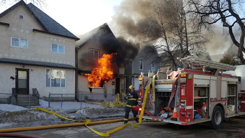 Crews fight West End house fire