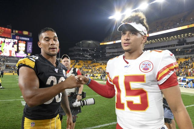 Pittsburgh Steelers running back James Conner (30) shakes hands with Kansas City Chiefs quarterback Patrick Mahomes (15) after a preseason NFL football game Saturday, Aug. 17, 2019, in Pittsburgh. The Steelers won 17-7. (AP Photo/Barry Reeger)