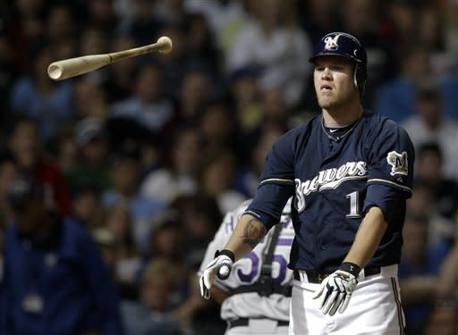 Milwaukee Brewers' Corey Hart tosses his bat after striking out to end the eighth inning of a baseball game against the Colorado Rockies, Sunday, April 22, 2012, in Milwaukee. (AP Photo/Morry Gash)