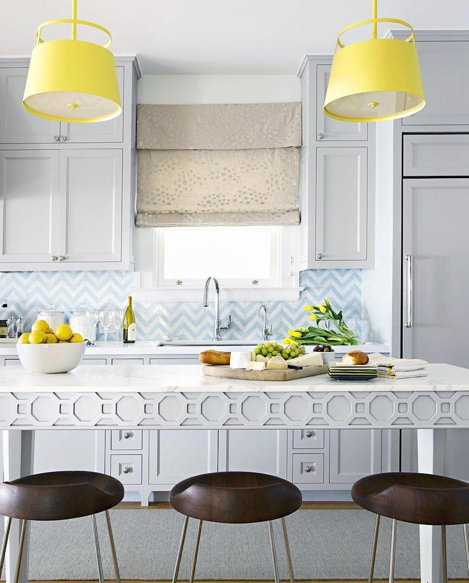 <p>A trendy blue-and-white chevron backsplash blends seamlessly with this kitchen's gray tones. </p>
