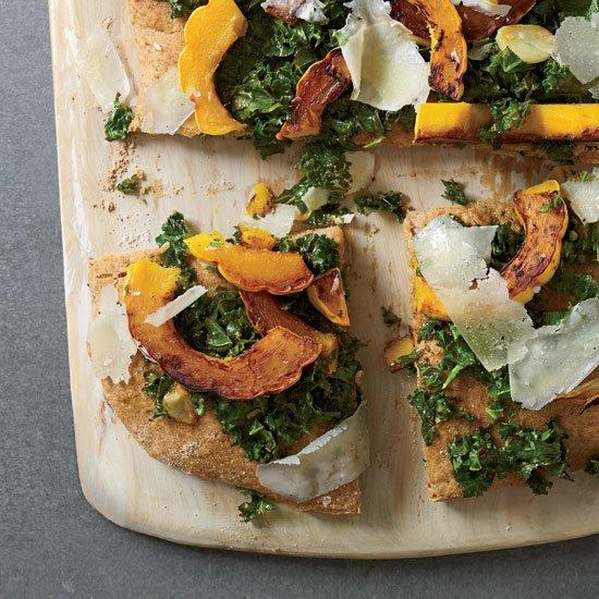 """<p>Chef Paul Kahan shares his healthy alternative to pizza. He replaces traditional dough with focaccia made with spelt flour, which is high in protein and gives the bread an appealingly hearty texture. Instead of using an excessive amount of cheese or meat, he tops the focaccia with tangy marinated kale, soft and sweet slices of winter squash and a few shavings of nutty, salty pecorino cheese.</p><p><a href=""""https://www.foodandwine.com/recipes/spelt-focaccia-with-kale-squash-and-pecorino"""">GO TO RECIPE</a></p>"""
