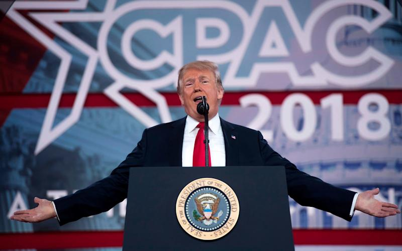 US President Donald Trump speaks during the 2018 Conservative Political Action Conference (CPAC) - AFP