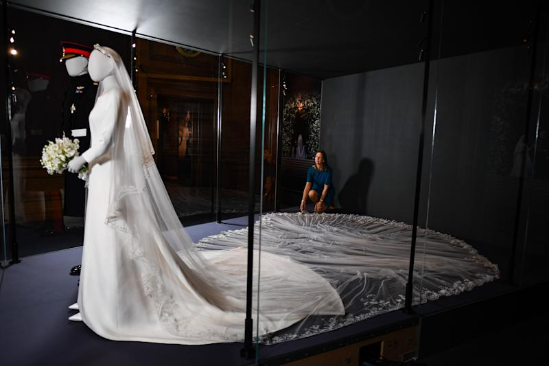 EDINBURGH, SCOTLAND - JUNE 13: Senior Curator Caroline de Guitaut views the wedding outfits of the Duke and Duchess of Sussex, as they go on display at the Palace of Holyroodhouse for a special exhibition, 'A Royal Wedding: The Duke and Duchess of Sussex' which is being shown from June 14 to October 6, on June 13, 2019 in Edinburgh, Scotland. (Photo by Jeff J Mitchell/Getty Images)