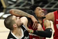 Los Angeles Clippers center Ivica Zubac, left, and Houston Rockets center Christian Wood battle for a rebound during the second half of an NBA basketball game Friday, April 9, 2021, in Los Angeles. The Clippers won 126-109. (AP Photo/Mark J. Terrill)