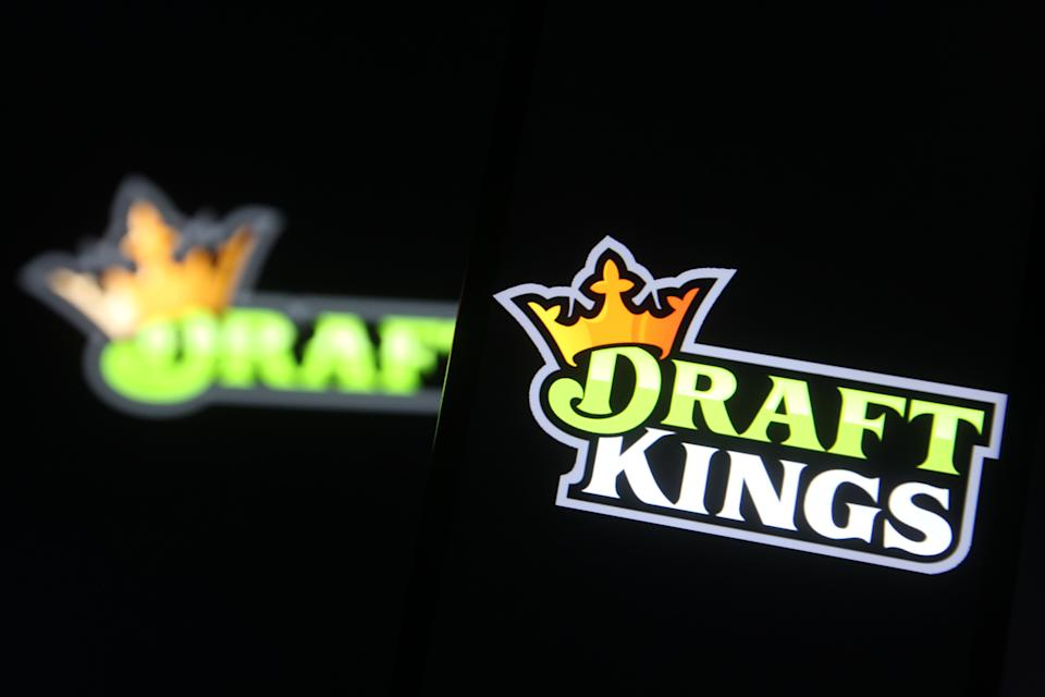 In this photo illustration a DraftKings logo, of the U.S. daily fantasy sports contest and sports betting operator, is seen on a mobile phone screen. (Photo by Pavlo Gonchar / SOPA Images/Sipa USA)