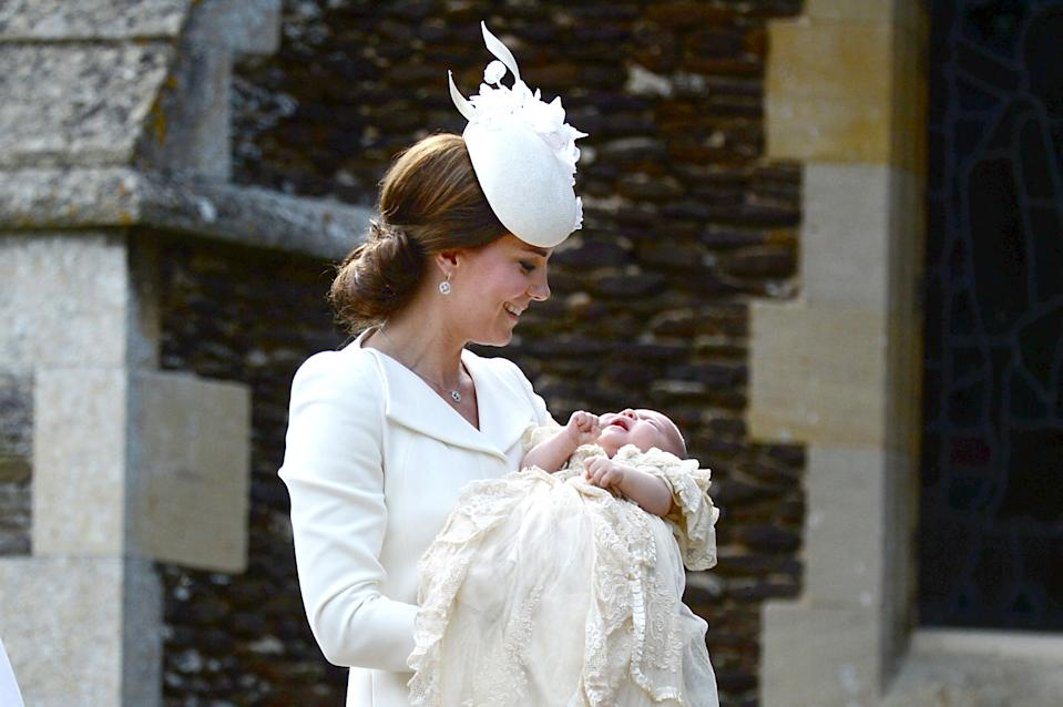 KING'S LYNN, ENGLAND - JULY 05:  Catherine, Duchess of Cambridge and Princess Charlotte of Cambridge arrive at the Church of St Mary Magdalene on the Sandringham Estate for the Christening of Princess Charlotte of Cambridge on July 5, 2015 in King's Lynn, England.  (Photo by Mary Turner - WPA Pool/Getty Images)