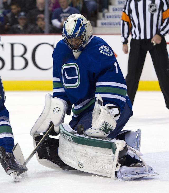 VANCOUVER, CANADA - JANUARY 21: Goalie Roberto Luongo #1of the Vancouver Canucks stops a shot from the San Jose Sharks during the first period in NHL action on January 21, 2012 at Rogers Arena in Vancouver, British Columbia, Canada. (Photo by Rich Lam/Getty Images)
