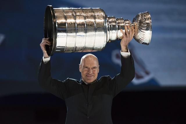 Former NHL star Mark Messier hold up the Stanley Cup at a Rogers and NHL event in Toronto on Tuesday, Feb. 4, 2014. Nearly 500 regular season games will air in Canada as part of the blockbuster 12-year agreement between Rogers Communications and the NHL. (AP Photo/The Canadian Press, Aaron Vincent Elkaim)