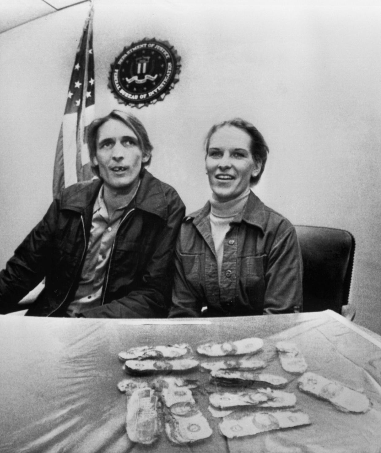 Howard and Patricia Ingram of Vancouver, Wash., sit with several thousand dollars the FBI announced was paid to legendary hijacker D.B. Cooper, on Tuesday, Feb. 12, 1980 in Portland, Ore. The couple's son Brian found the money on a picnic on Sunday. (AP Photo)