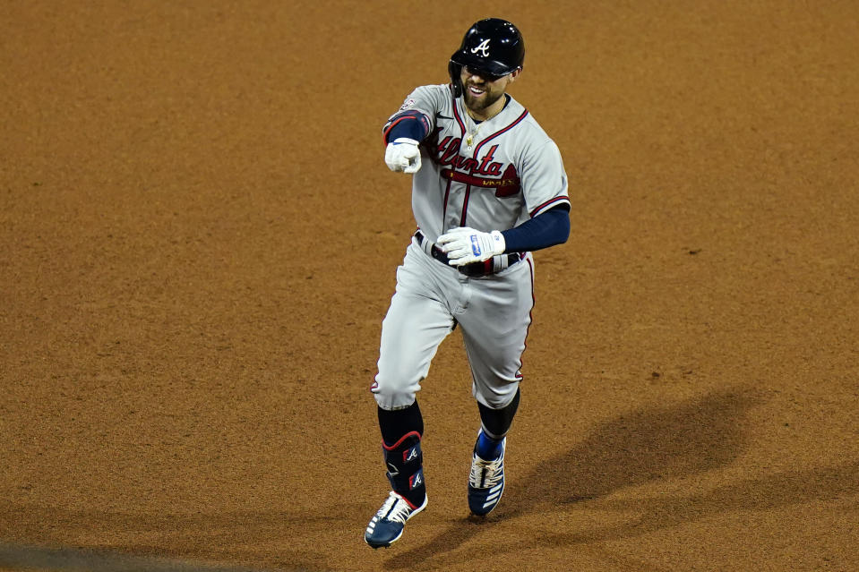 Atlanta Braves' Ender Inciarte reacts as he rounds the bases after hitting a home run off Philadelphia Phillies pitcher Adam Morganduring the seventh inning of a baseball game, Friday, Aug. 28, 2020, in Philadelphia. (AP Photo/Matt Slocum)