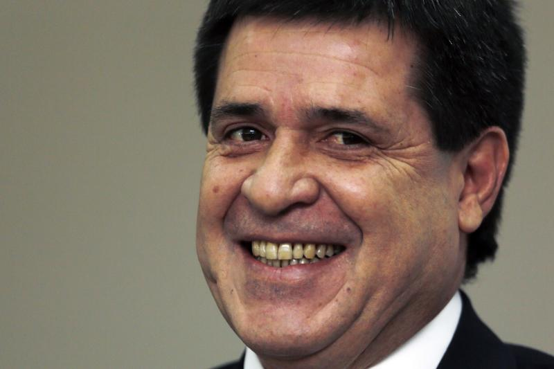 Paraguay's President-elect Horacio Cartes smiles as he introduces members of his cabinet during a news conference in Asuncion, Paraguay, Monday, Aug.12, 2013. Cartes a will be inaugurated on Thursday Aug. 15. (AP Photo/Jorge Saenz)