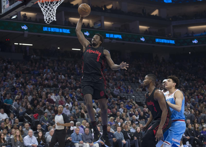 The Portland Trail Blazers' Al-Farouq Aminu (8) dunks after a steal against the Sacramento Kings at the Golden 1 Center in Sacramento Calif., on Friday, Feb. 9, 2018. (Hector Amezcua/Sacramento Bee/TNS via Getty Images)