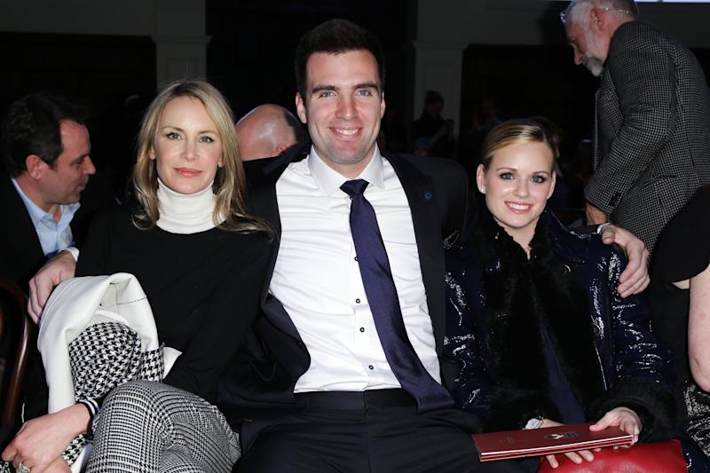 This image released by Starpix shows Dee Hilfiger, wife of designer Tommy Hilfiger, left, with Baltimore Ravens quarterback Joe Flacco and his wife Dana Grady at the Tommy Hilfiger Men's Fall 2013 collection, Friday, Feb. 8, 2013 during Fashion Week in New York. (AP Photo/Starpix, Andrew Toth)