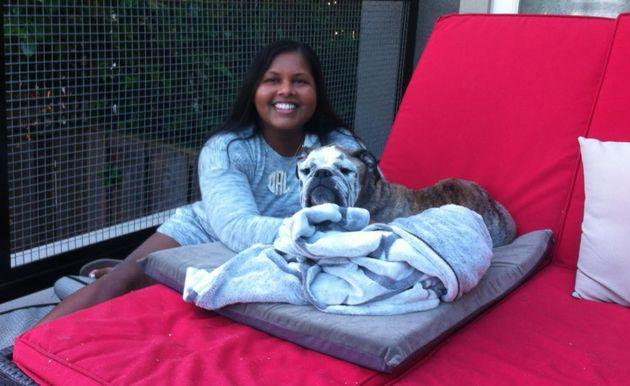 The author with her dog in 2016 when she was enrolled in her Ph.D. program. (Photo: Courtesy of Nandini Maharaj)