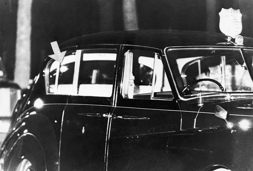 A photo of the Rolls-Royce in which Princess Anne and her husband  Mark Phillips were travelling, at the scene of an attempted kidnap on the princess in Pall Mall, London, 20th March 1974. An arrow indicates a bullet hole in one of the car's rear windows.