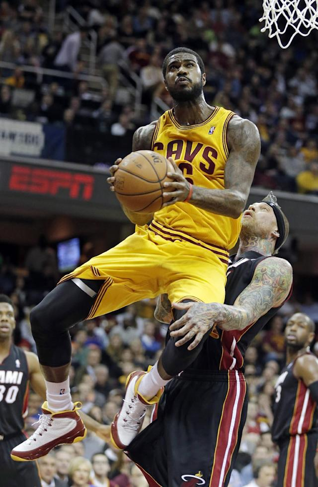 Cleveland Cavaliers' Earl Clark goes in for a shot against Miami Heat's Chris Andersen in the second quarter of an NBA basketball game Wednesday, Nov. 27, 2013, in Cleveland. (AP Photo/Mark Duncan)
