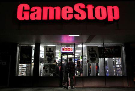 "People enter a GameStop store during ""Black Friday"" sales in Carle Place, New York November 25, 2011.  REUTERS/Shannon Stapleton/File Photo"
