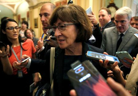 Senator Susan Collins (R-ME) is surrounded by journalists as she walks from a Republican Senate caucus meeting with U.S. Vice President Mike Pence on Capitol Hill in Washington, U.S., September 26, 2018. REUTERS/Joshua Roberts