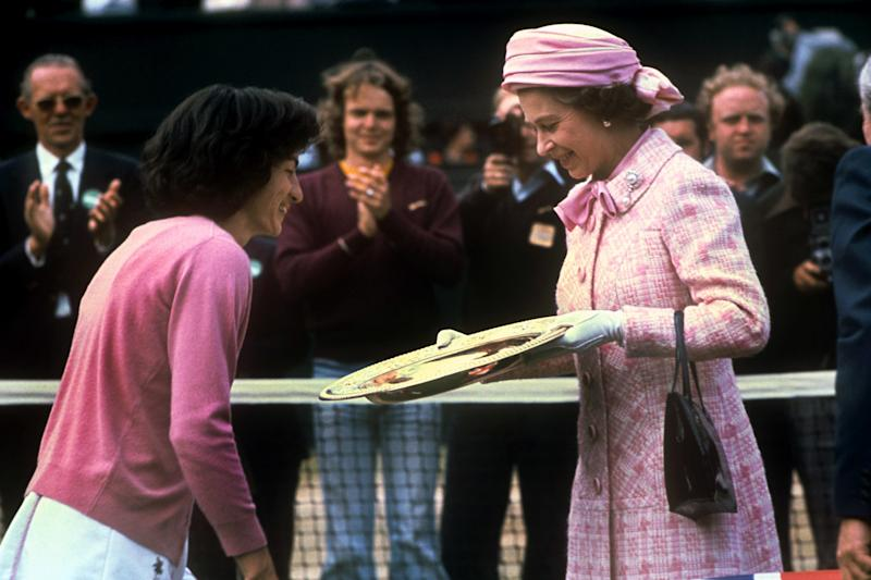 Queen Elizabeth II awards Virginia Wade the Wimbledon Ladies' Singles trophy on July 1st, 1977. Photo courtesy of Getty Images.