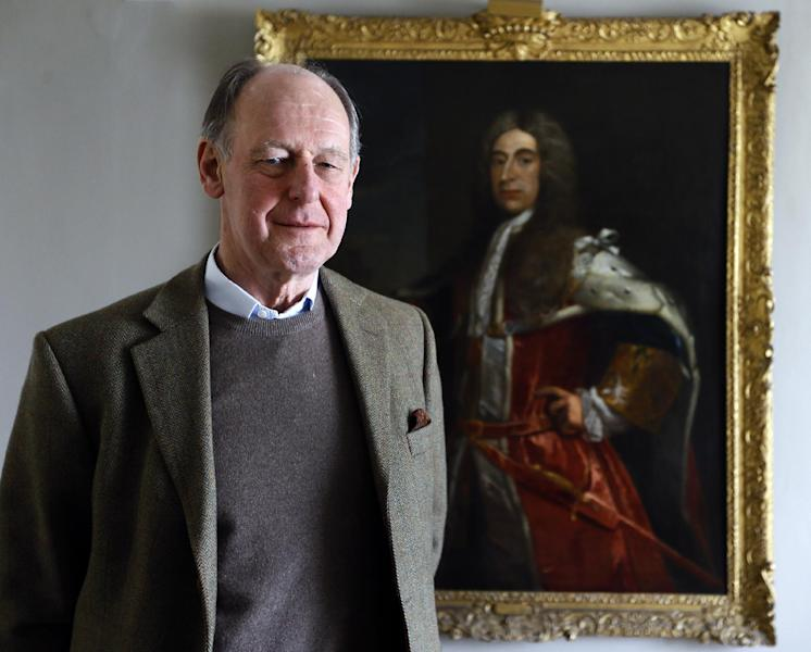 """Timothy Torrington the 11th Viscount Torrington stands with a painting of his ancestor Admiral Sir George Byng the 1st Viscount Torrington, in Mere, Somerset, England, Monday, April 8, 2013. Viscount Timothy Torrington's story reads like a real-life version of """"Downton Abbey,"""" the hit period drama about the family of an earl who has no direct heir to inherit his title. Like the fictional character Lord Grantham, the aristocrat has three daughters but no sons. In order for his title to live on in future generations, the 69-year-old has no choice but to pass it to a distant relative abroad, someone he has not even met. (AP Photo/Kirsty Wigglesworth)"""