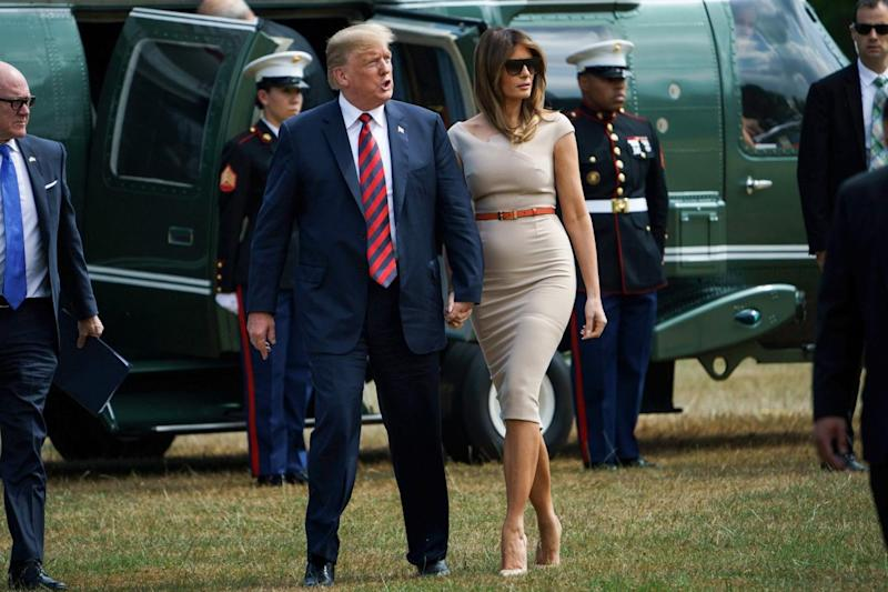 US President Donald Trump (C) and US First Lady Melania Trump (R) walk with US Ambassador to the United Kingdom Woody Johnson (L) as they arrive at the US ambassador's residence Winfield House in London (AFP/Getty Images)