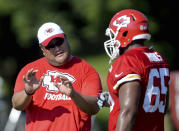 FILE - Then-Kansas City Chiefs assistant offensive line coach Eugene Chung, left, talks with lineman Tavon Rooks (65) during NFL football training camp practice n St. Joseph, Mo., in this Sunday, Aug. 2, 2015, file photo. Former NFL player and coach Eugene Chung is still waiting to meet with Commissioner Roger Goodell regarding an anti-Asian comment he says a team made about him during a job interview this year. Chung said on a conference call Monday, July 26, 2021, that he never was told by the league why a requested meeting with Goodell was not arranged nor how the NFL's investigation was conducted. (Andrew Carpenean/The St. Joseph News-Press via AP, File)